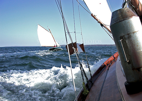 Overtaking a Gaft rigged sloop.