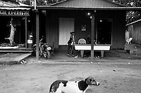 Sunday afternoon leisure time at Agua Branca gold mining village, Para State, Amazon, Brazil. Prostitution in a bar beside an open-air butcher's shop.