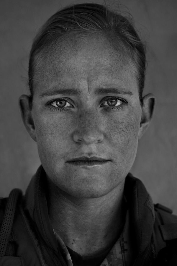 Marine Capt. Ann Gildroy, 31. Westford, MA. Taken at FOB Echo in Diwaniyah, Iraq. Gildroy is one of three Marines assigned to the so-called Team Phoenix - a team which reports to Gen. David Petraeus directly and is tasked with working in areas with limited US presence to organize tribal and Iraqi Army security forces and advise Coalition militaries in counter-insurgency methods.