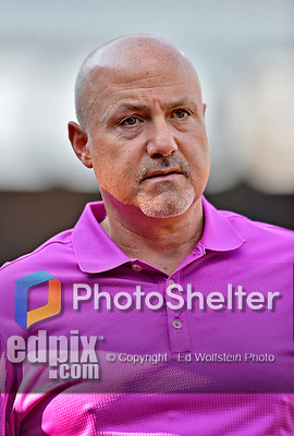 24 July 2012: Washington Nationals General Manager Mike Rizzo watches batting practice prior to a game against the New York Mets at Citi Field in Flushing, NY. The Nationals defeated the Mets 5-2 to take the second game of their 3-game series. Mandatory Credit: Ed Wolfstein Photo