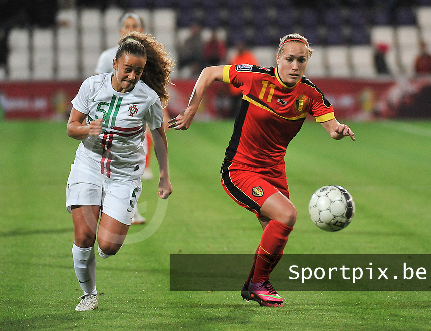 20131031 - ANTWERPEN , BELGIUM : Belgian Janice Cayman (11) pictured in a duel with Portugese Matilde Fidalgo (5) during the female soccer match between Belgium and Portugal , on the fourth matchday in group 5 of the UEFA qualifying round to the FIFA Women World Cup in Canada 2015 at Het Kiel stadium , Antwerp . Thursday 31st October 2013. PHOTO DAVID CATRY