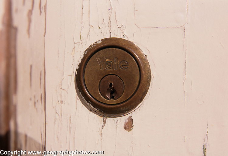 A793P6 Brass Yale key hole on wooden house door