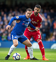 Eden Hazard of Chelsea holds off Miguel Angel Britos of Watford during the Premier League match between Chelsea and Watford at Stamford Bridge, London, England on 21 October 2017. Photo by Andy Rowland.