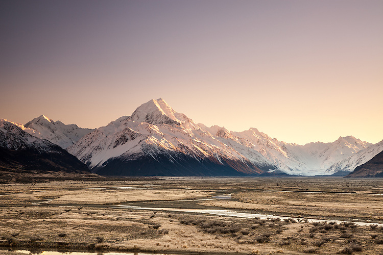 Winter sunrise looking up the Tasman Valley towards Aoraki / Mount Cook covered in snow, Mackenzie Country, Canterbury, New Zealand - stock photo, canvas, fine art print