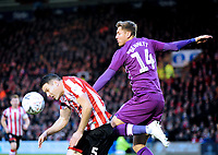 Lincoln City's Jason Shackell vies for possession with Carlisle United's Richard Bennett<br /> <br /> Photographer Andrew Vaughan/CameraSport<br /> <br /> The Emirates FA Cup Second Round - Lincoln City v Carlisle United - Saturday 1st December 2018 - Sincil Bank - Lincoln<br />  <br /> World Copyright © 2018 CameraSport. All rights reserved. 43 Linden Ave. Countesthorpe. Leicester. England. LE8 5PG - Tel: +44 (0) 116 277 4147 - admin@camerasport.com - www.camerasport.com