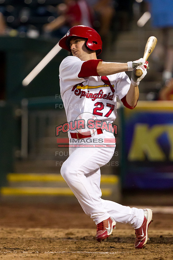 Shane Robinson (27) of the Springfield Cardinals follows through his swing during a game against the Tulsa Drillers at Hammons Field on July 19, 2011 in Springfield, Missouri. Tulsa defeated Springfield 17-11. (David Welker / Four Seam Images)