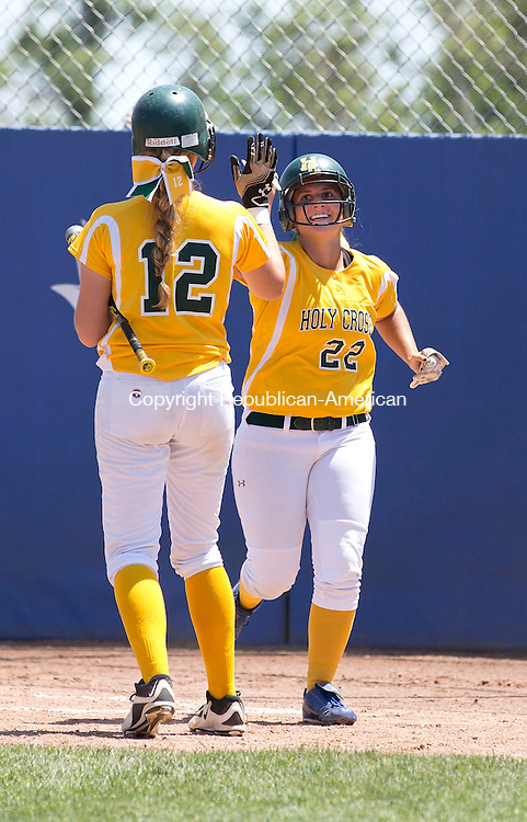 West Haven, CT- 13 June 2015-061315CM10-   Holy Cross' Paige Hine #12 congratulates teammate, Casey DiZinno #22 after scoring a run during their 4-0 win over Thomaston during the Class S state softball final in West Haven on Saturday.  Christopher Massa Republican-American