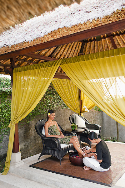 Woman receiving floral foot bath at Rebab Spa, Kayumanis Gangsa, Bali, Indonesia.  Every treatment at the Rebab Spa begins with a foot bath.