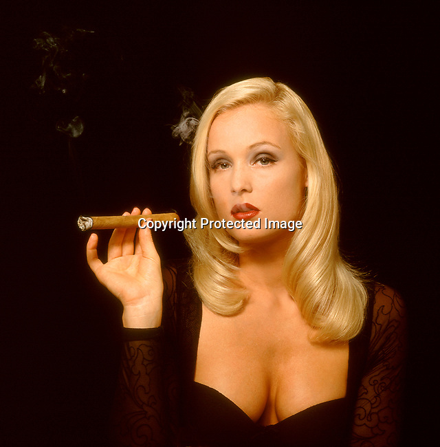 Beautiful woman smoking a cigar