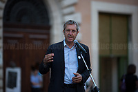 """Benedetto Della Vedova MP.<br /> <br /> Rome, 27/07/2020. Today, hundreds of people, NGO's (ONG) representatives, actors and politicians gathered in Piazza San Silvestro (near the Italian Parliament) to protest (1.) against the dramatic situation in Libya - erupted in a civil war between the GNA (2.) and the forces of General Khalifa Belqasim Haftar - and to protest against the inhumane conditions of migrant people trapped in legal and illegal prisons in Libya. The aim of the demo was to call the Italian Government to stop funding the """"Libyan Coast Guard"""" and to immediately help and free People in Libya throughout """"Humanitarian Corridors"""", and give them the protection they are entitled of by the International Human Rights Conventions. <br /> From the organisers Facebook event page: «[…] we meet to ask the Italian Government and the European States to stop funding the so-called Libyan coast guard, to close and evacuate the detention centres by transferring migrants out of Libya and to promote corridors to help people on the run find protection without endangering their lives. The men, women and children who take the sea from the Libyan coast flee from situations of extreme misery, despotic regimes, tribal persecutions, ethnic conflicts, wars and environmental catastrophes. And in Libya they are subjected to violence, extortion, detention, torture, rape and torture. A few days ago, on July 16, the Chamber of Deputies [Of the Italian Parliament, ndr] for the fourth consecutive year approved the financing of the Italian mission in Libya, which provides financial support for the so-called Libyan coastguard and training and training of its members. […] The mobilization will be accompanied by readings by Ascanio Celestini, Valentina Carnelutti, Fabrizio Gifuni and Sonia Bergamasco […]».<br /> <br /> Footnotes & Links:<br /> 1. https://www.facebook.com/events/2732849460337428/<br /> 2. 07.05.19 Prime Minister of Libya Fayez al-Serraj Met Italian PM Giuseppe Conte at Palazzo"""