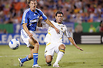 Sep 27 2007:  Ante Jazic (4) of the Galaxy beats Sasha Victorine (9) of the Wizards to a loose ball.  The MLS Kansas City Wizards were defeated by the visiting Los Angeles Galaxy 1-0 at Arrowhead Stadium in Kansas City, Missouri, in a regular season league soccer match.