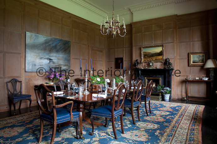 The panelling in the formal dining room is said to be from one of the yachts owned by the second Duke of Westminster, who bought the property in 1946