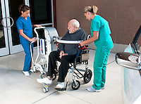 Nurses move patient to car using KCI device