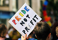 A Pride Not Profit placard held up as thousands of people take part in this year's Pride Parade in the centre of Cardiff, Wales, UK. Sayurday 26 August 2017