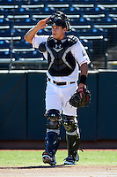 Phoenix Desert Dogs catcher J.T. Realmuto #4, of the Miami Marlins organization, during an Arizona Fall League game against the Mesa Solar Sox at Phoenix Municipal Stadium on October 19, 2012 in Phoenix, Arizona.  Phoenix defeated Mesa 10-6.  (Mike Janes/Four Seam Images)