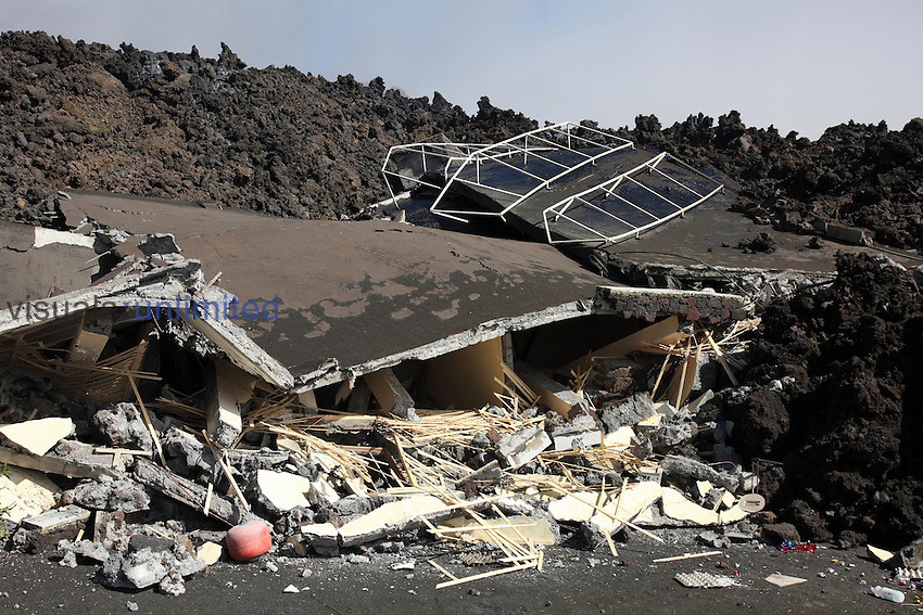 Aa lava flow from Fogo Volcano destroying building, Portela, Cape Verde