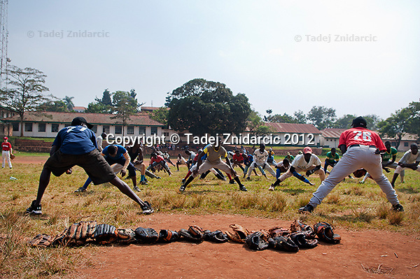 Ugandan baseball players warm up at sports field of St. Peter's school in Nsambya, neighbourhood of Kampala, Uganda on January 16 2012. The practice, part of Pearl of Africa Series, was led by MLB players Jimmy Rollins and Derrek Lee and by former MLB player Gregg Zaun.