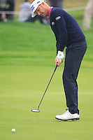 Mikko Ilonen (FIN) putts on the 5th green during Saturay's Round 3 of the 2014 BMW Masters held at Lake Malaren, Shanghai, China. 1st November 2014.<br /> Picture: Eoin Clarke www.golffile.ie