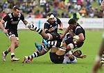 Akira Ioane is tackled. Blade Thomson and Ash Dixon support. Maori All Blacks vs. Fiji. Suva. MAB's won 27-26. July 11, 2015. Photo: Marc Weakley