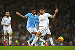 Raheem Sterling of Manchester City and Swansea's Jack Cork in action - Manchester City vs Swansea - Barclays Premier League - Etihad Stadium - Manchester - 12/12/2015 Pic Philip Oldham/SportImage