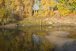 A sand bar and autumn reflections in Deep Creek, Boundary County, a tributary to the Kootenai River.