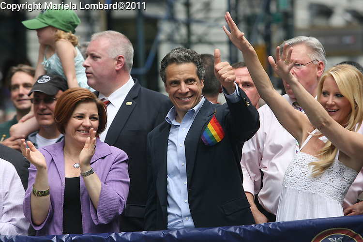 Gov Andrew Cuomo, Mayor Bloomberg and Speaker Christine Quinn march at the gay pride parade along Fifth Ave. in Manhattan.