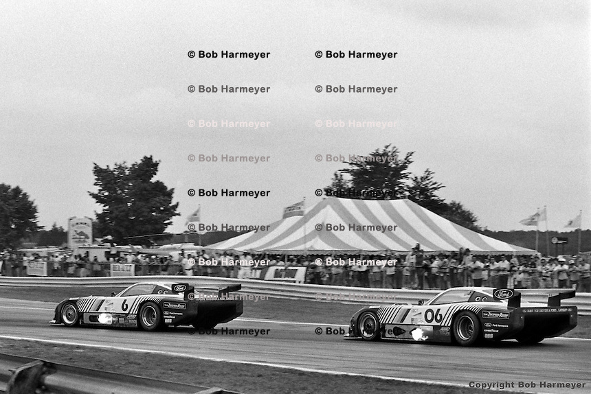 The Ford Mustang GTP team races in the 1983 IMSA event at Road America, Elkhart Lake, Wisconsin, USA. Drivers are Bobby Rahal-Geoff Brabham (#6), and Klaus Ludwig-Tim Coconis (#06).