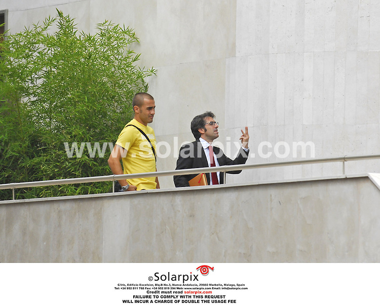 EXCLUSIVE PICTURES BY SOLARPIX.COM.**NO SYNDICATION IN SPAIN**.The Italian captain selection top player Fabio Cannovaro in Madrid with his wife and family purchasing an apartment in the upmarket super luxury section of Madrid in calle Valasquez today...DATE:15_09_06-JOB REF:2804-RAP.