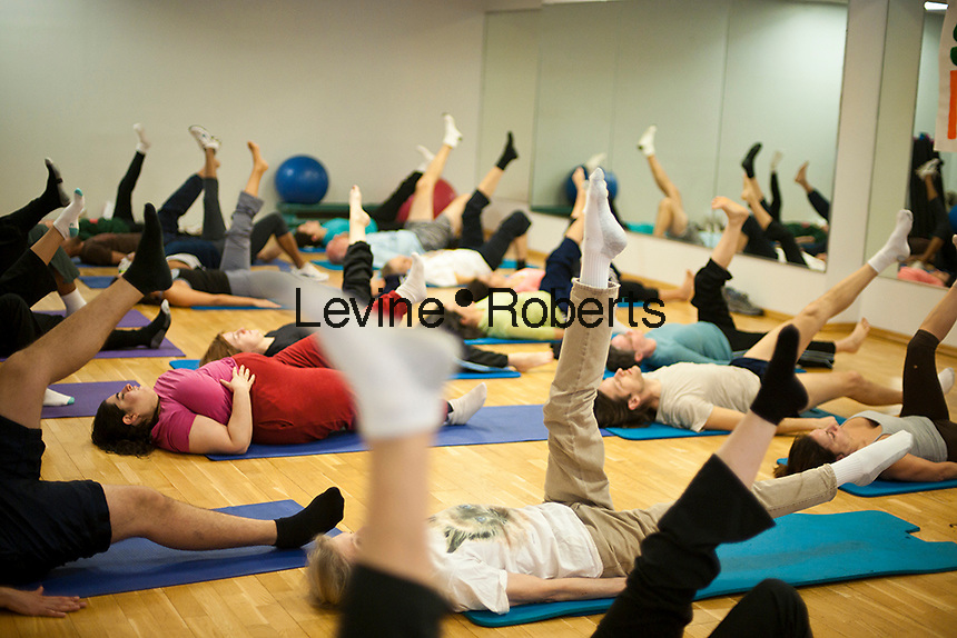 Exercisers participate in a pilates class at the Chelsea Recreation Center in New York on Tuesday, January 18, 2011 as part of the Parks & Recreation Dept. Shape Up NYC free fitness classes. The city is offering a free 12 week program to encourage physical activity and overall wellness in the recreation centers in the five boroughs. Participants are weighed and measured prior to starting the program with prizes to be awarded to the most successful on April 8, the end of Shape Up NYC. (© Richard B. Levine)