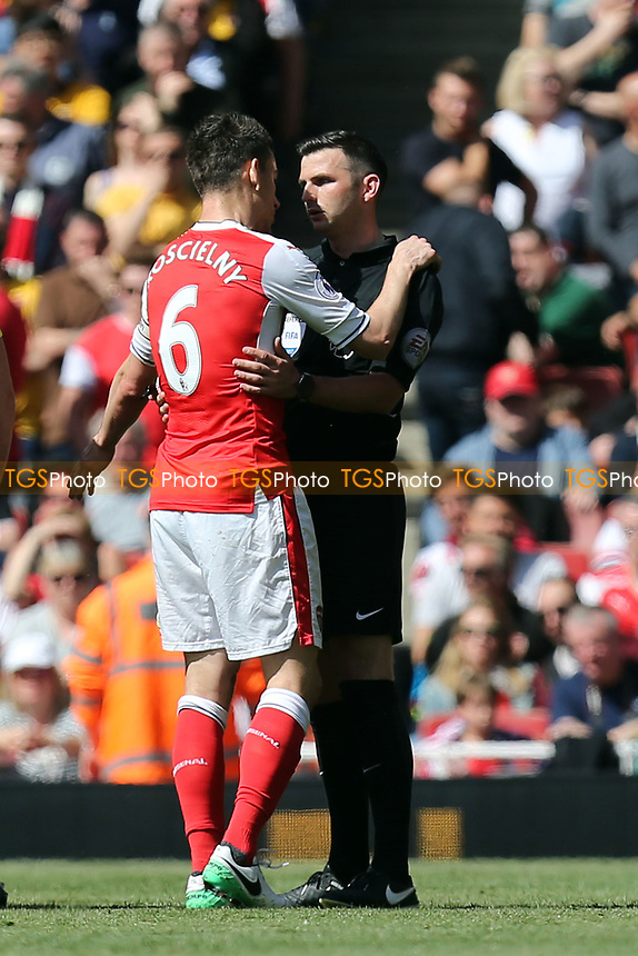 Laurent Koscielny of Arsenal appeals to referee Michael Oliver after being shown a red card during Arsenal vs Everton, Premier League Football at the Emirates Stadium on 21st May 2017