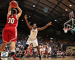 SIOUX FALLS, SD - MARCH 11:  Margaret McCloud #30 from the University of South Dakota looks to pass the ball over the defense of Shawnece Teague #23 from IUPUI in the first half of their semifinal game Monday afternoon during the Summit League Tournament in Sioux Falls, SD. (Photo by Dave Eggen/Inertia)