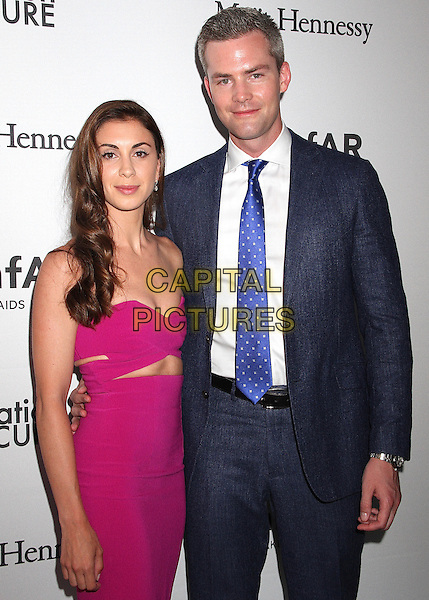 NEW YORK, NY - JUNE 21: Ryan Serhant and fiancee  Emilia Bechrakis attend amfAR generationCURE 5th Annual SOLSTICE event in New York, New York on June 21, 2016.  <br /> CAP/MPI/RMP<br /> &copy;RMP/MPI/Capital Pictures