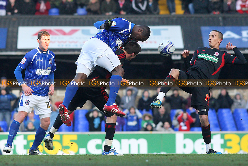 Ibrahima Sonko of Ipswich Town tangles with Rhys Williams of Middlesborough - Ipswich Town vs Middlesborough - nPower Championship Football at Portman Road, Ipswich, Suffolk - 11/02/12 - MANDATORY CREDIT: Gavin Ellis/TGSPHOTO - Self billing applies where appropriate - 0845 094 6026 - contact@tgsphoto.co.uk - NO UNPAID USE.