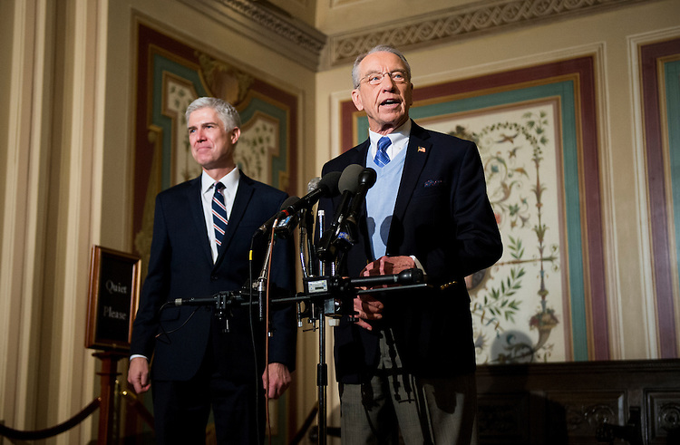 UNITED STATES - FEBRUARY 1: President Donald Trump's nominee for the Supreme Court Judge Neil Gorsuch, looks on as Senate Judiciary Committee chairman Sen. Chuck Grassley, R-Iowa, speaks to reporters following their meeting in the Capitol on Wednesday, Feb. 1, 2017. (Photo By Bill Clark/CQ Roll Call)