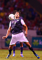 SAN JOSE, COSTA RICA - September 06, 2013: Omar Gonzalez (3) of the USA MNT pulls in a high ball against the Costa Rica MNT during a 2014 World Cup qualifying match at the National Stadium in San Jose on September 6. USA lost 3-1.