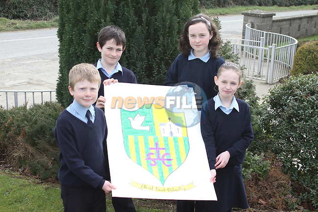 Joint first place winners Katie McConville and Emer Lawless with Ruairí Crofts (2nd place) and Callum Halpenny (3rd place) at the unveilling of the schools first Crest which was designed by the students...(Photo credit should read Jenny Matthews/www.newsfile.ie)....This Picture has been sent you under the conditions enclosed by:.Newsfile Ltd..The Studio,.Millmount Abbey,.Drogheda,.Co Meath..Ireland..Tel: +353(0)41-9871240.Fax: +353(0)41-9871260.GSM: +353(0)86-2500958.email: pictures@newsfile.ie.www.newsfile.ie.