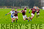 St Marys Paulie O'Donoghue with a scorable chance has his effort quashed by a superb block from Dromids Cian Ó Sé.