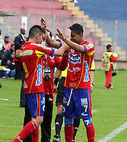 PASTO - COLOMBIA -15-02-2014: Los jugadores de Deportivo Pasto celebran el gol anotado a Universidad Autonoma durante partido Deportivo Pasto  y Universidad Autonoma por la fecha 12 de la Liga Postobon I 2014, jugado en el estadio Libertad de la ciudad de Pasto.  / The players of Deportivo Pasto celebrate a goal scored to Universidad Autonoma during a match Deportivo Pasto  and Universidad Autonoma for the date 12 th of the Liga Postobon I 2014 at the Libertad stadium in Pasto city. Photo: VizzorImage  / Leonardo Castro / Str.