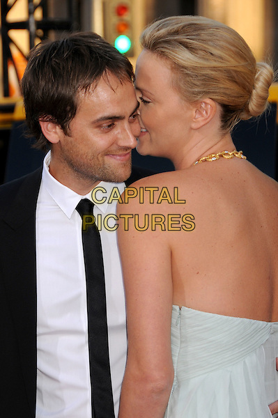 "STUART TOWNSEND & CHARLIZE THERON.""Hancock"" Los Angeles Premiere at Grauman's Chinese Theatre, Hollywood, California, USA..June 30th, 2008.half length black tie suit white shirt pale blue strapless dress gold necklace  couple stubble facial hair profile whispering in ear .CAP/ADM/BP.©Byron Purvis/AdMedia/Capital Pictures."