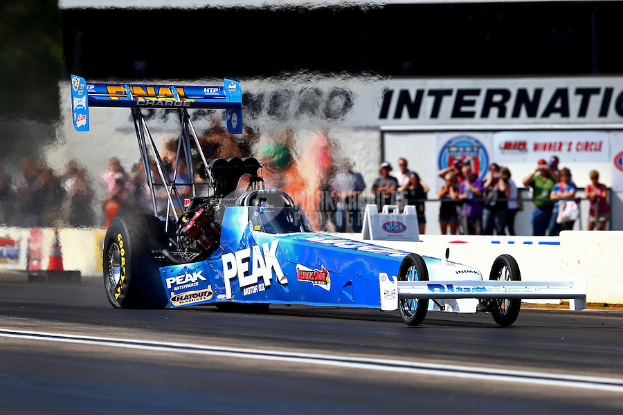 Aug. 17, 2013; Brainerd, MN, USA: NHRA top fuel dragster driver T.J. Zizzo during qualifying for the Lucas Oil Nationals at Brainerd International Raceway. Mandatory Credit: Mark J. Rebilas-