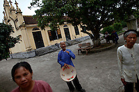 Leprosy affected Vietnamese people leave the church after Sunday service in their isolated village of Van Mon south of Hanoi October 24, 2010. More than 600 leprosy affected people live their humble lives with government support in an isolated village founded by French Catholics priests 110 years ago. Leprosy, or Hansen's disease, is caused by the Mycobacterium leprae. It affects the skin, mucous membranes, peripheral nerves and eyes.  REUTERS/Damir Sagolj (VIETNAM)