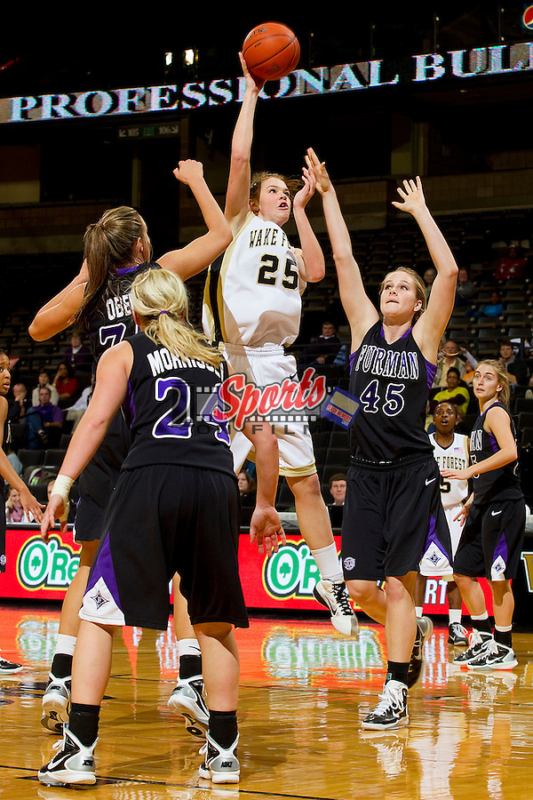 Jaymee Carnes #25 of the Wake Forest Demon Deacons shoots over three Furman Paladins defenders at the Lawrence Joel Coliseum on December 22, 2010 in Winston-Salem, North Carolina.  The Demon Deacons defeated the Paladins 84-35.  Photo by Brian Westerholt / Sports On Film