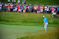 Rory McIlroy (NIR) watches his chip on to 12 during Friday's round 2 of the 117th U.S. Open, at Erin Hills, Erin, Wisconsin. 6/16/2017.<br /> Picture: Golffile | Ken Murray<br /> <br /> <br /> All photo usage must carry mandatory copyright credit (&copy; Golffile | Ken Murray)