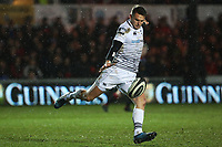 Dan Bigger of Ospreys kicks the ball away during the Guinness Pro 14 match between Newport Gwent Dragons and Ospreys at the Rodney Parade in Newport, Wales, UK. Sunday 31 December 2017