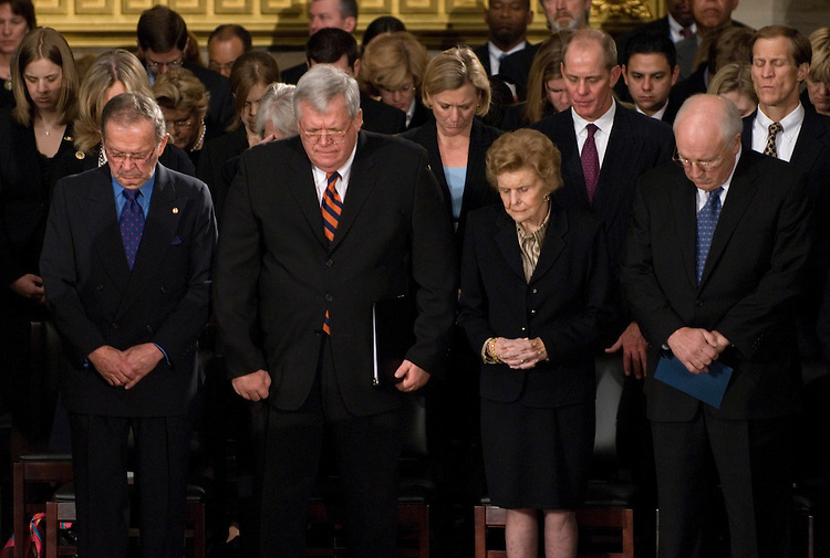 From left, Sen. Ted Stevens, Speaker of the House Dennis Hastert, Betty Ford, and Vice President Dick Cheney, bow their heads during the state funeral for former President Gerald Ford in the Rotunda of the U.S. Capitol in Washington on Saturday evening, Dec. 30, 2006.