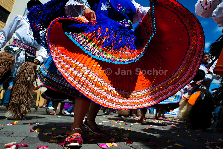 A girl dancer (danzante) performs in the religious parade within the Corpus Christi festival in Pujilí, Ecuador, 1 June 2013. Every year in June, thousands of people gather in a small town of Pujili, high in the Andes, to celebrate the Catholic feast of Corpus Christi. Introduced originally during the Spanish conquest of South America, this celebration merges Catholic rituals of Holy Communion with the traditional Andean harvest and sun festivities (Inti, the Inca sun god). Women dancers perform wearing brightly colored costumes while men dancers wear chest ornaments and heavy elaborate headdresses adorned with mirrors, jewelry, or natural items (shells). Being a dancer in the Corpus Christi ceremonial parade (El Danzante) is considered an honour and a privilege by the indigenous people in Ecuador.