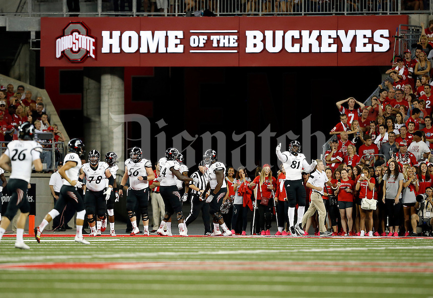 Cincinnati Bearcats players celebrate a touchdown during the second quarter of the NCAA football game at Ohio Stadium in Columbus on Sept. 27, 2014. (Adam Cairns / The Columbus Dispatch)