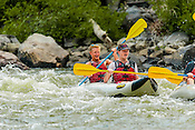 Colorado River Guides crashing Cable Rapid while floating the Upper Colorado River from Rancho Del Rio to Two Bridges on the morning of August 17, 2014.