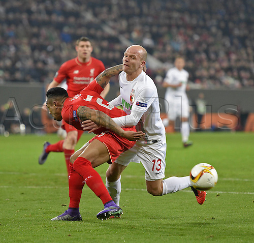 18.02.2016. Augsburg, Germany. UEFA Europa League football. Augsburg versus Liverpool FC.  Nathhaniel Clyne (FC Liverpool) manhandled by Tobias Werner (FC Augsburg)