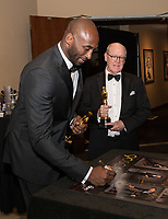 Kobe Bryant signs posters backstage with the Oscar&reg; for best animated short film for work on &ldquo;Dear Basketball&rdquo; during the live ABC Telecast of The 90th Oscars&reg; at the Dolby&reg; Theatre in Hollywood, CA on Sunday, March 4, 2018.<br /> *Editorial Use Only*<br /> CAP/PLF/AMPAS<br /> Supplied by Capital Pictures